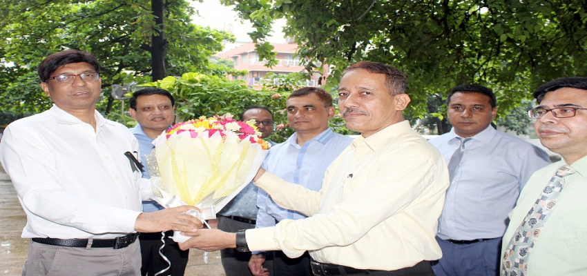 Officers of BIAM Foundation, Dhaka are welcoming newly joined Director General with flowers.